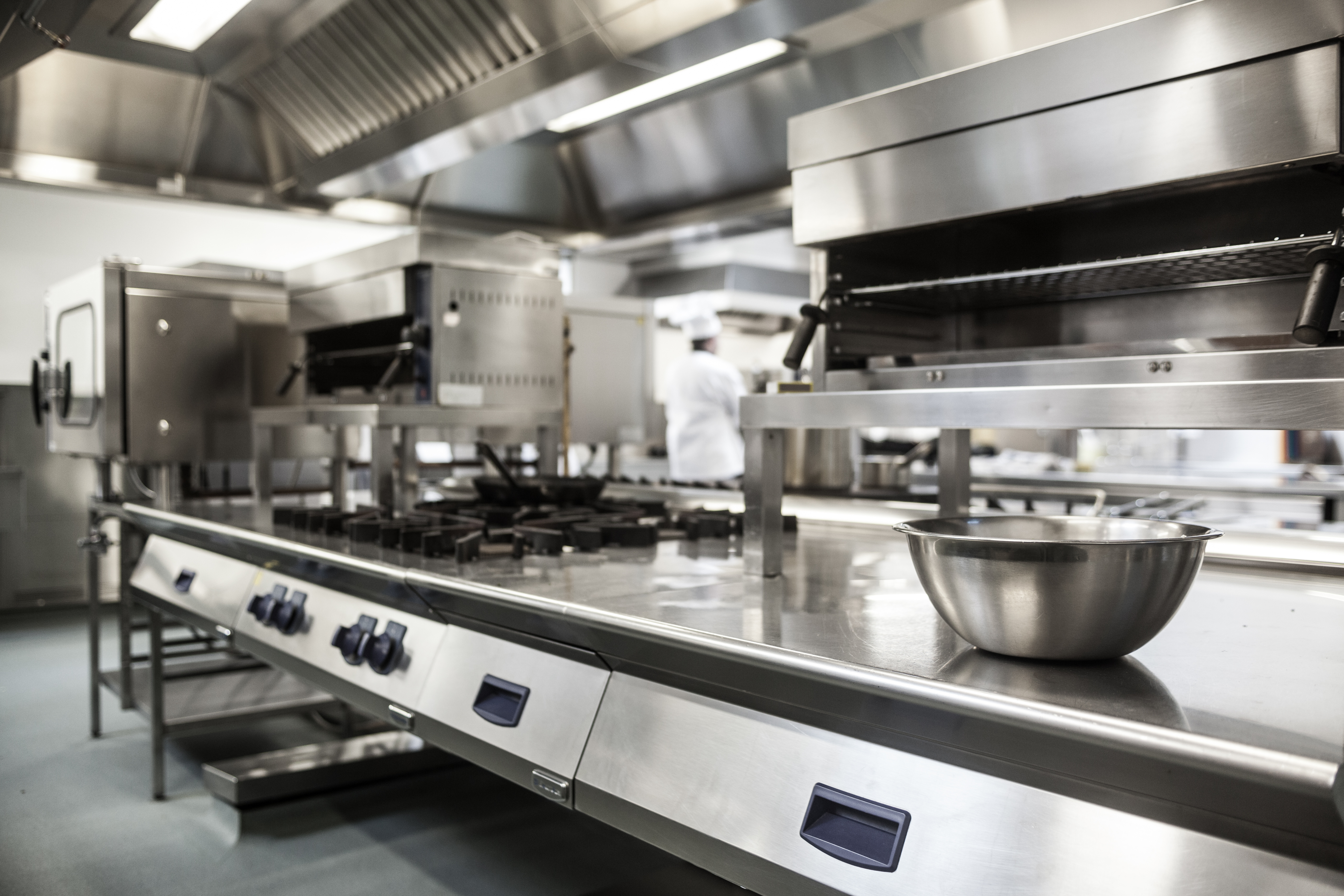 work surface and kitchen equipment in professional kitchen - Professional Kitchen